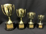 12 Series Classic Cup with Figure on Sculpted Round Black Base GOLD CUP TROPHIES